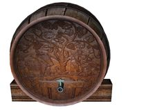 Engraved Wooden Wine Cask. Wooden wine cask with a vineyard carving, tap and spigot Stock Photo