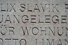 Engraved words. German words engraved on a plaque on building stock image