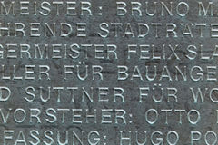 Engraved words. German words engraved on a plaque on building royalty free stock photos