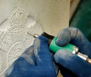 Engraver. Person Engraving an inscription onto Stone Royalty Free Stock Image