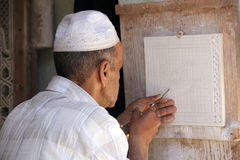 Engraver. An engraver who prepares a decorative tile in Marrakech stock images