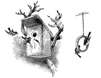 Engraving of bird house and food ring. Engraving of wooden bird house on tree and birds hanging from a birdseed ring Royalty Free Stock Image