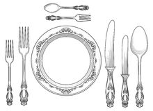 Engraving cutlery and dinner plates Royalty Free Stock Photo
