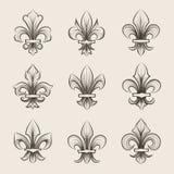 Engraving fleur de lis icons set Royalty Free Stock Image