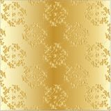 Engraving on gold with the floral pattern Royalty Free Stock Photo
