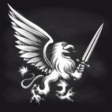 Engraving griffin with sword on chalkboard Royalty Free Stock Image