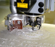Engraving Machine. Precision Stone Engraving Machine carving an inscription stock photos