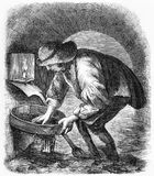 The sewer hunter during the Victorian era. Engraving of a sewer hunter commonly at work cleaning the sewers of London during the Victorian era. From an original Royalty Free Stock Images
