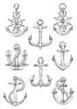 Engraving sketched anchors with helms and ropes Stock Photos