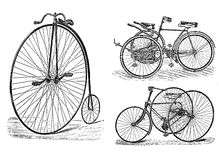 Engraving of vintage tricycle and bike. Royalty Free Stock Photos