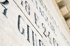 Engravings on commemorative monument Stock Photos