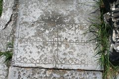 Engravings at the Shops at Philippi. These engravings are near the shops at the agora of Philippi. Likely carved by merchants or slaves who spent time passing at royalty free stock images