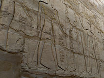 Engravings on the wall of the ancient temple of Egypt. Stock Photo