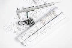 Engrenagem com o modelo da correia e do compasso de calibre Imagens de Stock