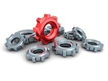 Engrenagens da roda denteada com o um líder vermelho do conceito Imagens de Stock