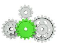 Engrenagens da roda denteada do grupo em torno da roda verde Fotos de Stock