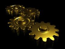 Engrenagens douradas Fotografia de Stock