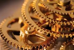 Engrenagens douradas imagem de stock royalty free