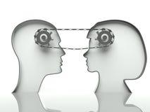 Engrenagens e corrente nas cabeças, conceito de uma comunicação ilustração stock
