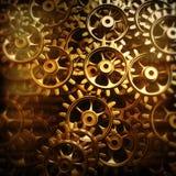 Engrenagens e rodas denteadas do ouro macro ilustração royalty free