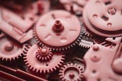 Engrenagens e rodas denteadas vermelhas Imagem de Stock