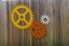 Engrenagens em uma cerca de madeira Imagens de Stock