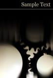 Engrenagens pretas com fundo preto com espaço da cópia Imagem de Stock