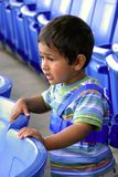 Engrossed. An young Indian kid engossed at a theatre Royalty Free Stock Photo