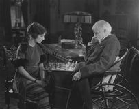 Engrossed in chess game Royalty Free Stock Image