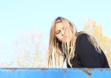 Engry girl. Cute hairy blonde girl - engry kid in black pullover Royalty Free Stock Photos