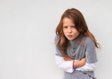 Engry girl. Cute hairy brunette girl - engry kid in pullover Royalty Free Stock Photo