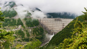 Enguri hydro power plant with morning fog in Georgia. Royalty Free Stock Photography