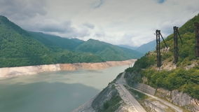 The Enguri hydroelectric power station HES. Inguri River next to Enguri Dam, surrounded by mountains. Upper Svaneti, Georgia. Second highest concrete arch dam stock video footage