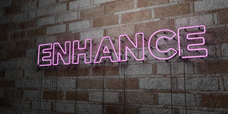 ENHANCE - Glowing Neon Sign on stonework wall - 3D rendered royalty free stock illustration. Can be used for online banner ads and direct mailers Royalty Free Stock Image