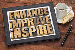 Enhance, improve, inspire. A collage of motivational word in vintage letterpress wood type on a digital tablet Stock Photo