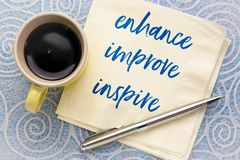 Enhance, improve, inspire concept on napkin royalty free stock images