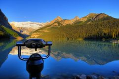 Enhance your vision. Coin-operated binocular in the front of Lake Louise, Canada Stock Image