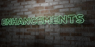 ENHANCEMENTS - Glowing Neon Sign on stonework wall - 3D rendered royalty free stock illustration Royalty Free Stock Photo