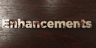 Enhancements - grungy wooden headline on Maple  - 3D rendered royalty free stock image. This image can be used for an online website banner ad or a print Stock Photo