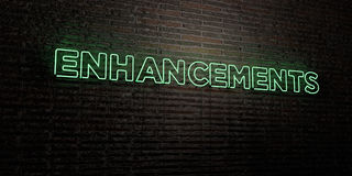 ENHANCEMENTS -Realistic Neon Sign on Brick Wall background - 3D rendered royalty free stock image Stock Photos