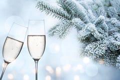 Enhorabuena hivernal con champán Fotografía de archivo