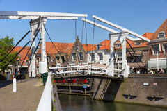 Enhuizen bridge. Draw bridge over a canal in the historic center of Enkhuizen, The Netherlands. The city was once one of the harbour-towns of the VOC Royalty Free Stock Photos