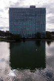 Eni headquarter reflects over a lake in rome. Skyscraper reflects over the laghetto delleur (eur lake) in rome, iraly Stock Photos