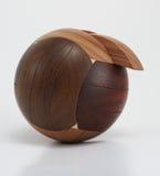 Enigma de madeira da esfera no fundo branco Imagem de Stock