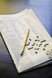 Enigma de palavras cruzadas da manhã Fotografia de Stock