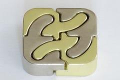 Enigma do ferro fundido prata do nad do ouro do cubo de 4 partes fotografia de stock royalty free