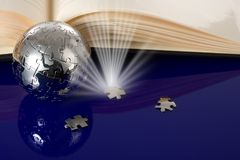 Enigma do globo com livro foto de stock royalty free
