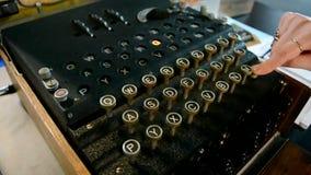 Enigma machine under processing, vintage security technology,. AMSTERDAM: Enigma machine under processing on September 15, 2014 in Amsterdam, Netherlands stock footage
