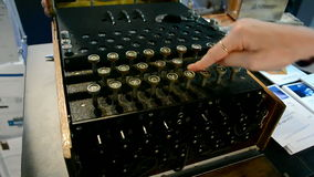 Enigma cipher machine under processing, vintage technology, stock footage