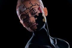 Enigmas pintados na cara Imagem de Stock Royalty Free